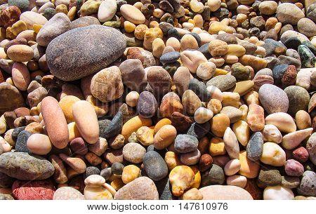 Brilliant peebles on a sunny day on the beach