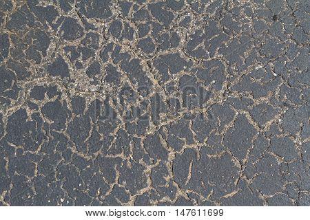 cracked black sealed pavement grunge grim texture