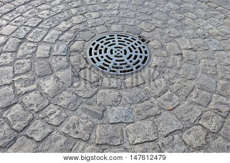 Manhole With Drainage Sewerage in Circle of Cobblestones