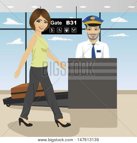 young woman passes security check control while policeman inspects a baggage with x ray machine