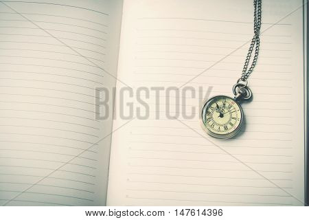 Vintage pocket watch on books vintage tone