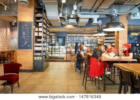 MOSCOW, RUSSIA- AUGUST 24, 2016: inside of Starbucks coffee shop. Starbucks Corporation is an American coffee company and coffeehouse chain.