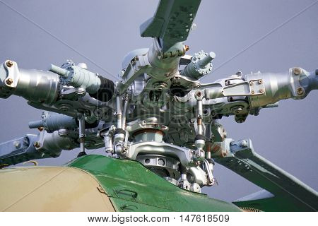 the blades of a helicopter, parts of the helicopter