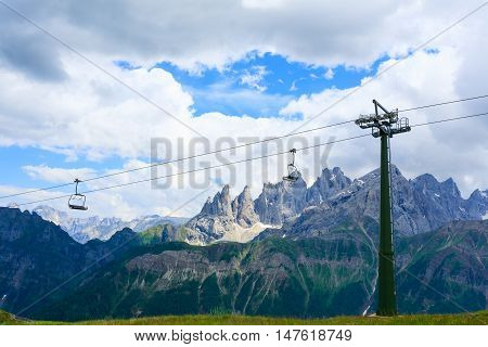 Italian alps panorama from top of a mountain. Sky lift detail. Outdoor sport