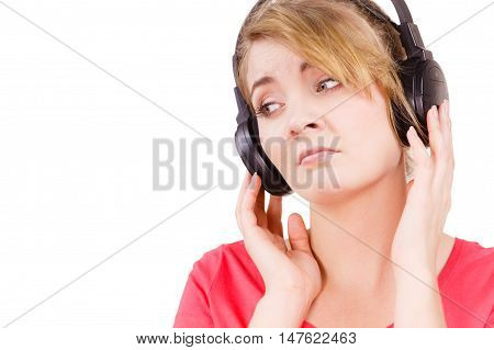 Woman sad unhappy girl in big headphones listening music mp3 closeup on white. Broken heart love concept