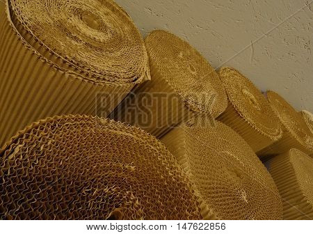 Cellulose industry. Rolled corrugated cardboard at the paper storage