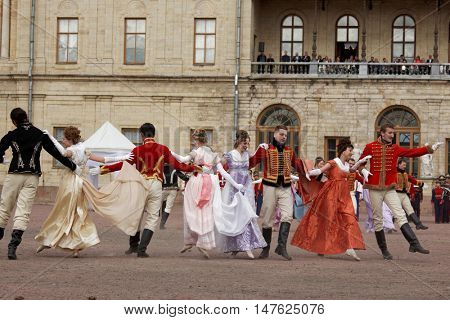 GATCHINA, ST. PETERSBURG, RUSSIA - SEPTEMBER 10, 2016: Actors in retro costumes dancing in the show during the festival Gatchinskaya Byl. The festival is held first time this year