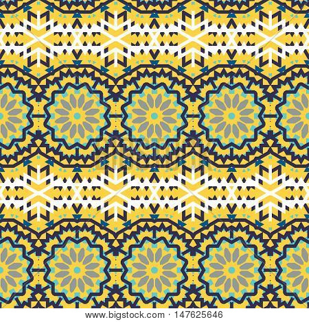 Vector ethnic bohemian pattern in bright yellow color with abstract ethnic flowers. Geometric boho chic background with Arabic, Indian, Moroccan, Aztec ethnic motifs. Bold bohemian tribal print
