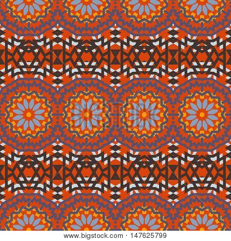 Vector ethnic colorful bohemian pattern in bright red colors with big abstract flowers. Geometric background with Indian, Moroccan, Aztec ethnic motifs. Bold tribal print for spring summer fashion