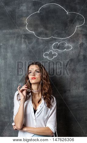 Young Thoughtful Woman Near Blackboard With Blank Think Cloud