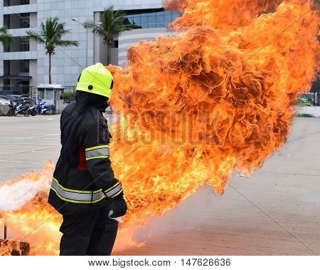 fireman face with fire.He prepare fire hydrant.