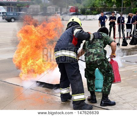 fireman training fire hydrant with security staff.