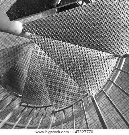 Spiral Stair Detail. Metal diamondplate staircase inside a farm silo.
