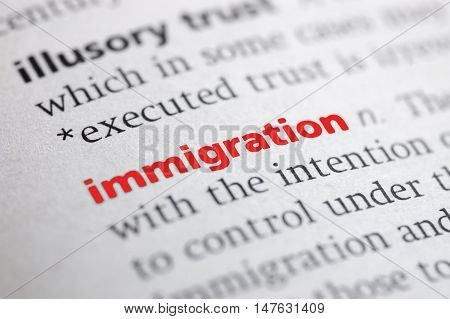 photo of Dictionary definition of Immigration. Close-up view