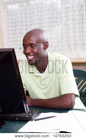 african american male student learning computer