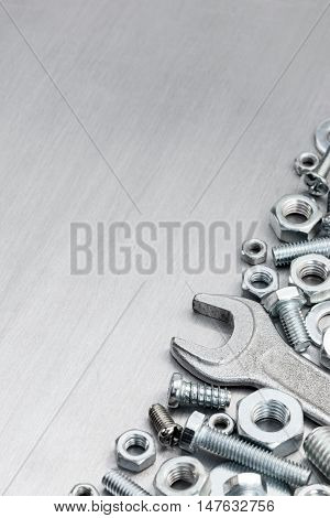 Standard Wrench, Screws And Bolt For House Renovation On Scratched Metal Background