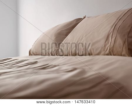 Brown bedding on bed