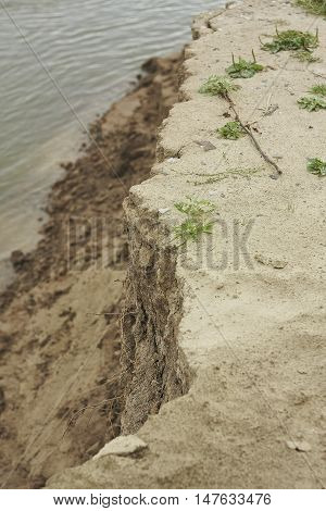 Irtish river bank collapse edge close up