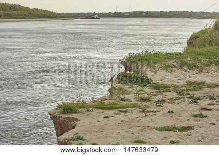 Irtish river bank collapse edge with grass