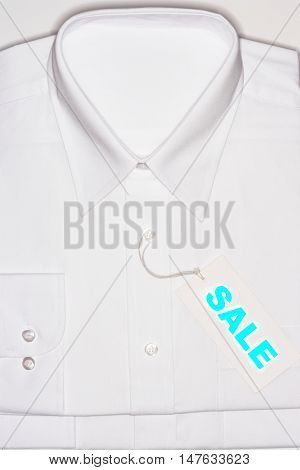 White Shirt with sale sign
