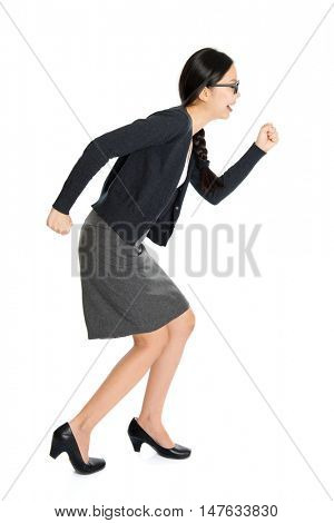 Full length portrait of young Asian female running, isolated on white background.