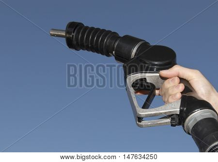 Holding a gas petrol nozzle