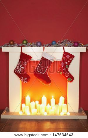 Christmas Stockings hanging over a fire