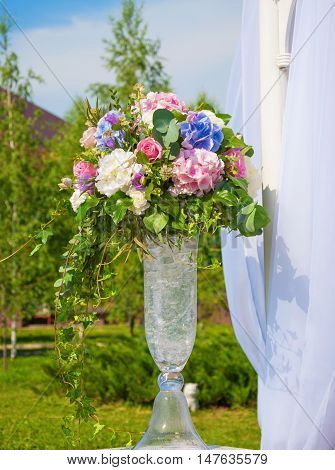 Elegant Bouquet of flowers on a background of white curtains