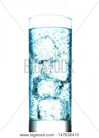 Carbonated drink with ice cubes on white background