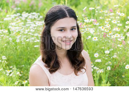 Portrait of a cute girl with hairstyle of long hair on the outside