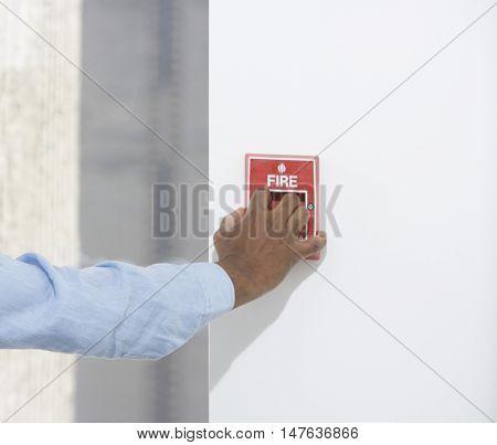 Closeup of am African American businessman starting fire alarm