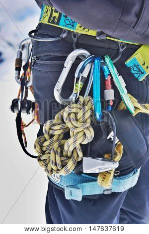 Closeup midsection of a hiker's belt filled with safety ropes