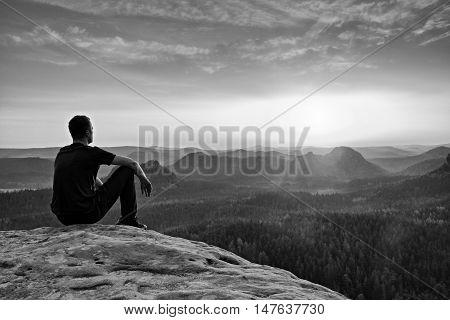 Tall Hiker In Mountains. Thinking Man Silhouette In Nature Within Daybreak.