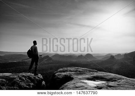 Man Hiker  At Mountain Peak. Marvelous Daybreak In Autumn Misty Landscape.