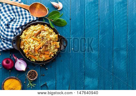 pilaf with rice and meat on wooden table