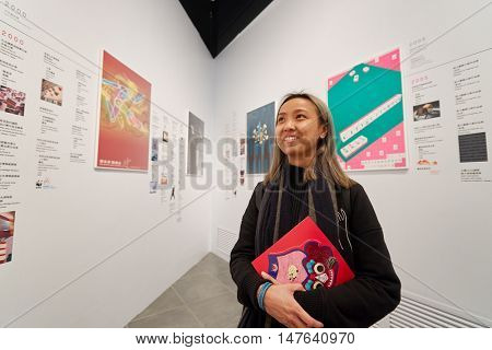 HONG KONG - JANUARY 29, 2016: indoor portrait of a woman in Hong Kong Heritage Museum. Hong Kong Heritage Museum is a museum of history, art and culture in Sha Tin, Hong Kong.