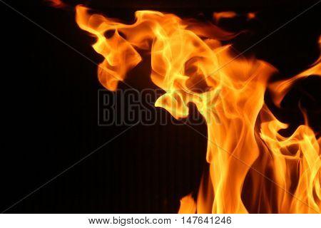 big wave of hellfire fire burns Black background