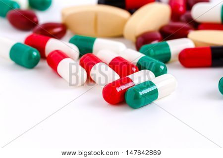 Pills and Colorful medical capsules on white background.