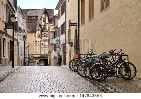 Tubingen, Germany - April 17, 2016: The narrow central pedestrian street with old half-timbered houses and a parked bicycle. Tubingen, Baden-Wurttemberg, Germany.
