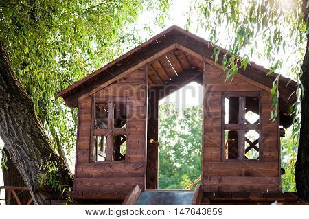 tree house with a slide on the playground at daytime