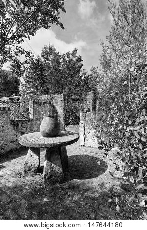 Ruined Potting Table And Pots In Brick Potting Shed In Black And White