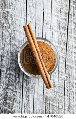 Cinnamon stick and ground cinnamon. Top view.