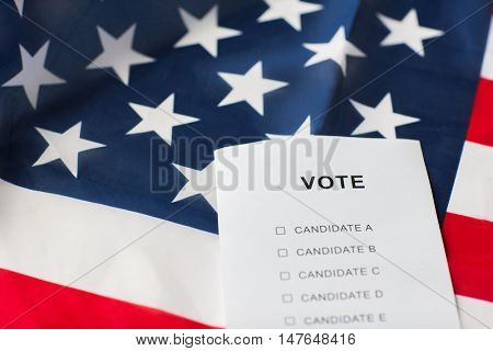 voting, election and civil rights concept - empty ballot or vote on american flag