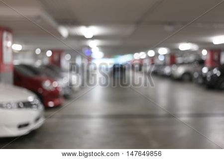 Blurred cars parking and bokeh light for the Parking location Concept to design background.
