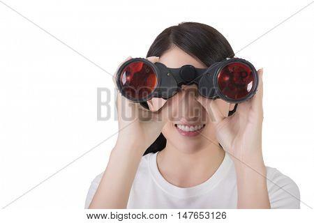 woman using binoculars, closeup portrait