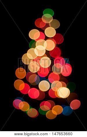 Decorative multicolour bokeh on the Christmas tree