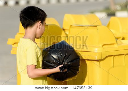 Boy Carry Garbage In Bag For Eliminate To The Bin