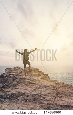 Young traveller with backpack enjoy the beauty of seascape Vintage tone