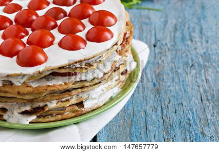 Zucchini Cake With Tomato And Parsley On A Blue Wooden