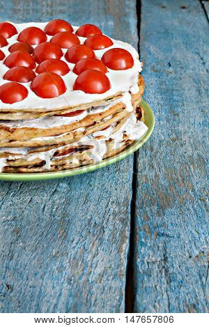 Zucchini Cake With Tomatoes On A Blue Wooden Background